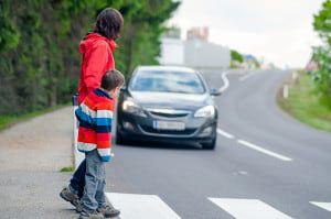 bigstock-Car-stopped-for-pedestrian-42758428